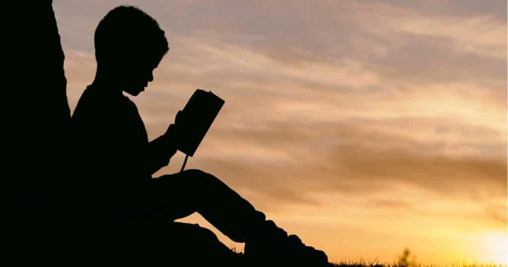 Child reading silhouette