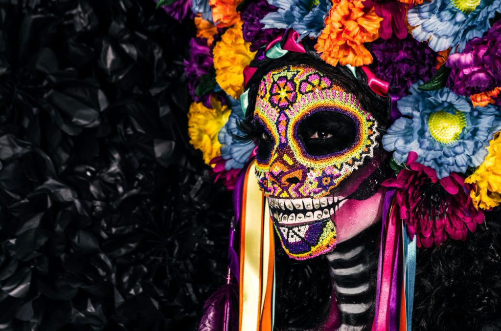 Colourful day of the dead skull face paint